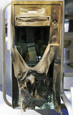 A computer highly damaged and melted by fire